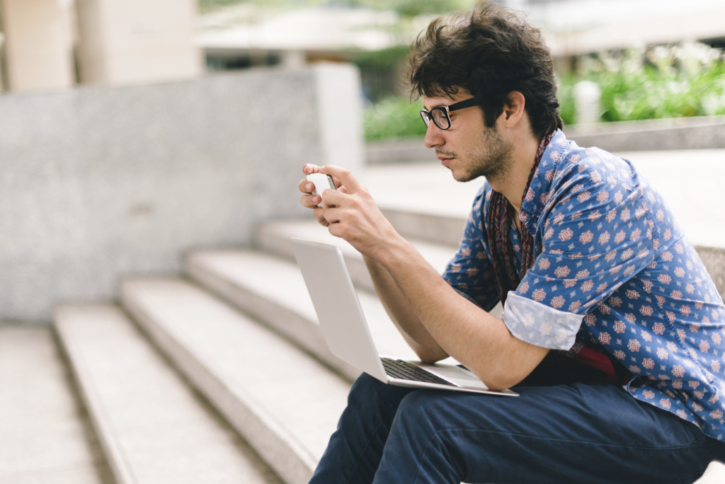 Man working remotely with enterprise mobility management and mobile device management